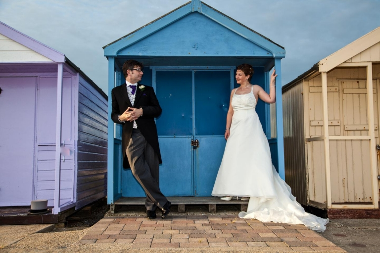 Wedding Couple photo in front of beach huts